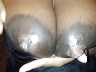 Ebony pumping milk out of her huge boobs and nipples