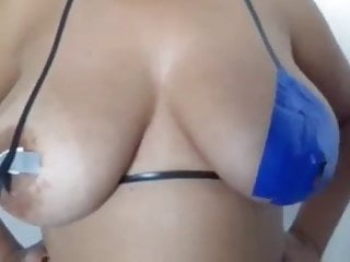 Taping busty Brazilian nipples for carnival