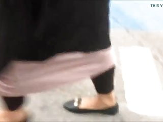 pakistani feet in black flat shoe