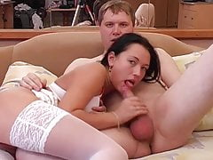 Smiley bargirl on hotel bed sucking a very thick cock