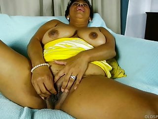 Busty old spunker talks dirty about titty fucking