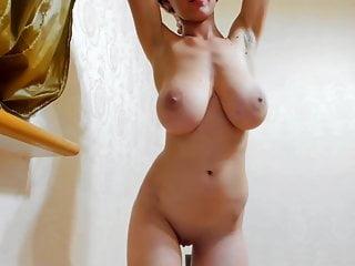 busty brunette girl shakes her boobs