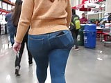 Latina fat ass and hips in tight jeans and wedge heel boots
