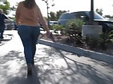 Latina with thick ass and hips in tight jeans and boots.