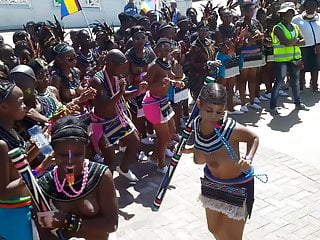 Topless Zulu girls dancing in the street