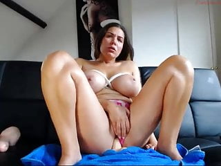 Busty brunette girl shows pussy