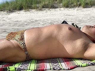 Sunbathing on the beach in AC 4